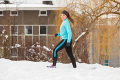 Winter sports, girl exercising in city Stock Image