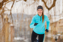 Winter sports, girl exercising in city Royalty Free Stock Image