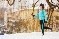 Winter sports, girl exercising in city Royalty Free Stock Images