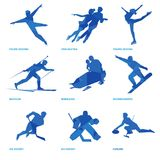 Winter sports icon set 2. Winter sports icon set. Nine silhouettes of athletes with deep blue pattern: pair and single skating, bobsleigh, ski, ice hockey Stock Images