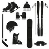 Winter sports icons on white background. Winter black sports icons on white background. Set of winter sports equipment. Vector illustration Royalty Free Stock Photography