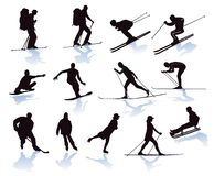 Winter sports illustrated. Thirteen illustrations of participants in various Winter sports shown in silhouette including, sledging, skiing, skating, ice hockey Stock Photos