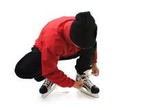 Winter sports man tying skates Stock Image