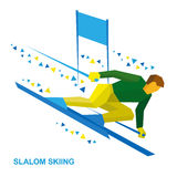 Winter sports - slalom skiing. Sportsman ski slope down. Stock Image