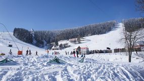 Winter sportsmen at the Fichtelberg. Winter sports area at the Fichtelberg in the Ore Mountains in Germany, cableway, chairlift and ski jump, winter sportsmen on Stock Images