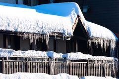Winter or spring background with bright icicles in the sunlight Stock Images