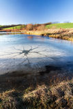 Winter/spring landscape with frozen pond Royalty Free Stock Images