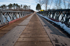 Winter -Spring. Winter  the last days and the first days of Spring in plain of  southeast of Europe.small bridge over the frozen lake who started to melt those Stock Image