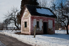Winter -Spring. Winter  the last days and the first days of Spring in plain of  southeast of Europe.small  old abandoned house...snow  started to melt those days Royalty Free Stock Image
