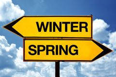 Winter or spring opposite signs. Two blank opposite signs against blue sky background Royalty Free Stock Images