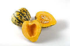 Winter Squash. Cut and whole winter squash on white background with shadows stock photos