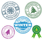 Winter stamps. Grunge rubber stamps set with mountains and the words Snow Guaranteed, Christmas and Winter inside Royalty Free Stock Photo