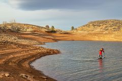 Winter stand up paddling in Colorado stock photography