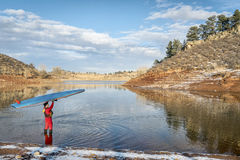 Winter stand up paddling in Colorado Royalty Free Stock Photo