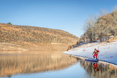 Winter stand up paddling in Colorado Royalty Free Stock Image