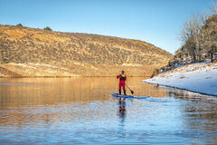Winter stand up paddling in Colorado Royalty Free Stock Photography