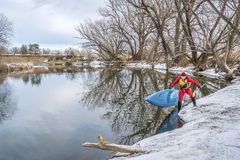 Winter stand up paddling Stock Images