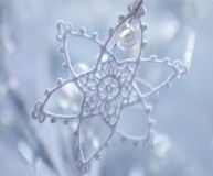 Winter star. Winter lace star with pearl Stock Images