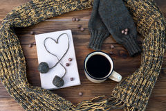 Winter still life with coffee, scarf and book on a wooden table Stock Photography