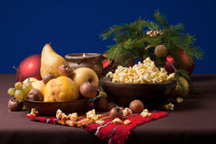 Winter still life. Still life with fruit and popcorn Stock Images