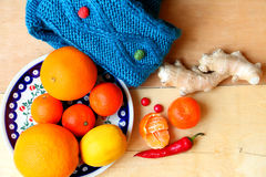 Winter still life with knitted items , tangerine, ginger  Royalty Free Stock Photo