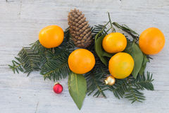 Winter still life with tangerines on a wooden table on the eve of New Year and Christmas. Waiting and preparation for the holiday. Christmas and New Year mood Stock Images