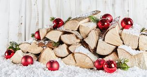 Winter stockpile of wood logs in snow at Xmas stock image