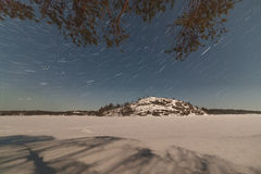 Winter, stony coast of night  lake. A winter landscape Royalty Free Stock Photography