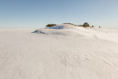 Winter, stony snow-covered island of Ladoga lake. A winter lands Stock Photo
