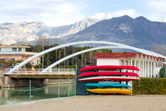 Winter storage of canoes colorful backdrop of snow-covered Alps Stock Photo