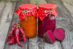 Winter stores in jars. Preparations for the winter vegetable canning jars. Winter stores in jars Stock Photography