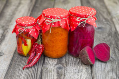 Winter stores in jars. Preparations for the winter vegetable canning jars. Winter stores in jars Royalty Free Stock Photography