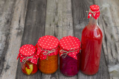 Winter stores in jars. Preparations for the winter vegetable canning jars. Winter stores in jars Royalty Free Stock Photos
