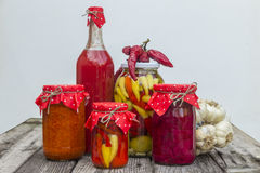 Winter stores in jars. Preparations for the winter vegetable canning jars. Winter stores in jars Stock Images