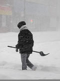 Winter storm. Massive winter storm in Chicago - February 2011. Woman with shovel on the street Stock Photography