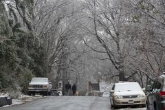People Walk Down the Street in Richmond, Virginia after Winter Storm Gia stock image