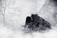 Winter storm. Grungy black and white image of an old fashioned steam locomotive in heavy winter storm Royalty Free Stock Photography