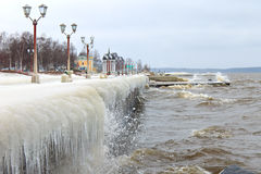 Winter storm on the lake and ice-covered city embankment Stock Photo