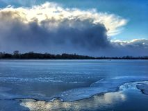 Winter storm over lake Stock Photography