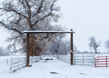 Winter storm at a ranch entrance Royalty Free Stock Photos