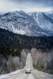 Winter Straight Road with Beautiful Snowy Mountains in Backgroun Royalty Free Stock Images