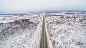 Winter straight road in Siberia. Russia aerial view Royalty Free Stock Photo
