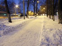 Winter street. Winter evening, snow and city lights Royalty Free Stock Photos