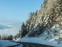 Winter street at early morning in Austrian mountains. Royalty Free Stock Image