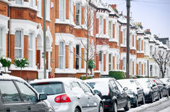 Winter Street in London. Snow covered Typical English Terraced Houses in London royalty free stock images