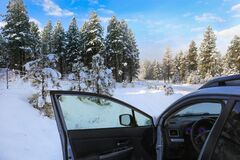 WInter Street With Lots Of Snow With Private Driveway And Car With Open Door And Gates Royalty Free Stock Photography