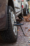 Winter Studded Tire Wheel Mounting On Car With Jack-screw At Autumn Royalty Free Stock Images