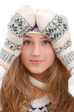 Winter style girl guiltily keeps hands on her head Royalty Free Stock Photo