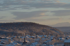 Winter suburb. On a background of hills and mountains. Russia, winter, Caucasus, Adygea Stock Photography