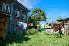 Clothes hanging on the line in the backyard of the old wooden residential house. Suzdal, Russia Stock Images